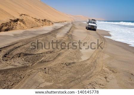 Safari trip alongside dunes and sea in Namibia - stock photo