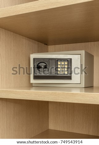 Safe box for storing valuables in a wooden cupboard. Inside