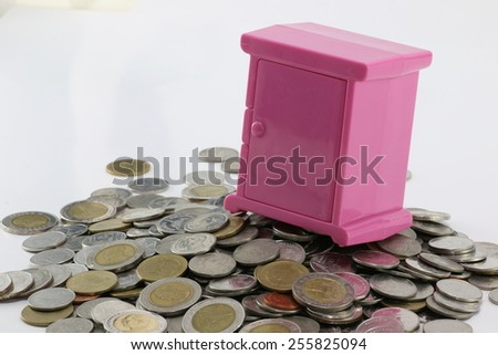 safe plastic placed on a pile of money. - stock photo