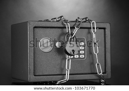 safe with chain and lock on grey background - stock photo