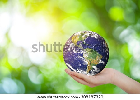 Safe world concept . Hand Holding world ball on white green bokeh.Copy Space on horizontal sheet.Elements of this image furnished by NASA.United Nations Climate Change Conference - stock photo