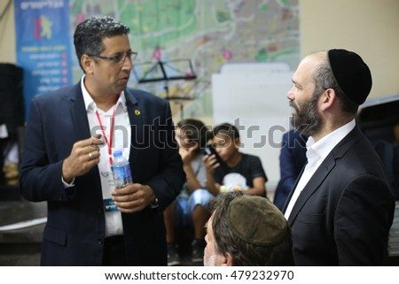 "SAFED, ISRAEL - AUGUST 16, 2016: Yonatan Razel, famous Israeli singer and Ilan Shohat is an Israeli politician, before  live in concert during the annual ""Kley Zemer"" festival in Safed."