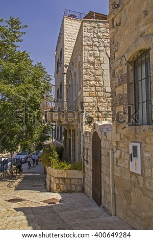 Safed,Israel -September 04,2015: Orthodox Jewish Children in the Typical street alley in Safed's old city with stone buildings.Since the 16th century,Safed has been the center of Kabbalah.