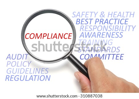 Safety and health at workplace conceptual, focus on the word Compliance