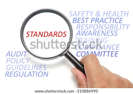Safety and health at workplace conceptual, focus on the word Standards