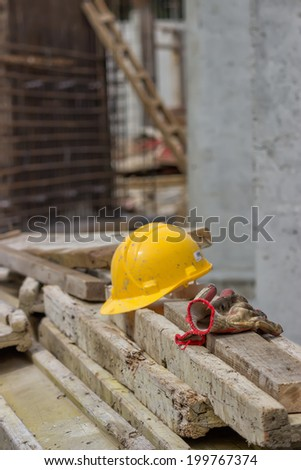 Safety at construction site. Helmet and gloves on the construction site. - stock photo