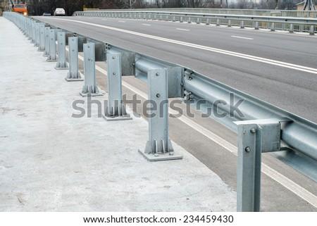 Safety barrier on freeway bridge - stock photo