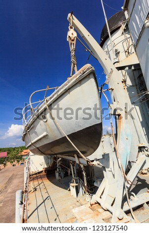 Safety boat on war ship - stock photo