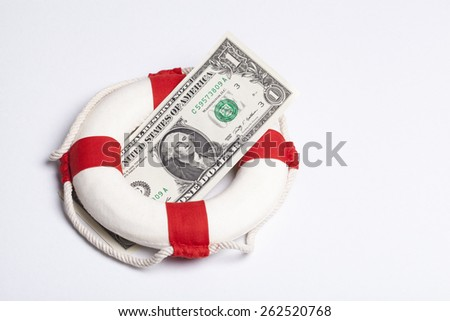 safety buoy with a one dollar banknote on a white background. financial concept for currency risk or protection  - stock photo