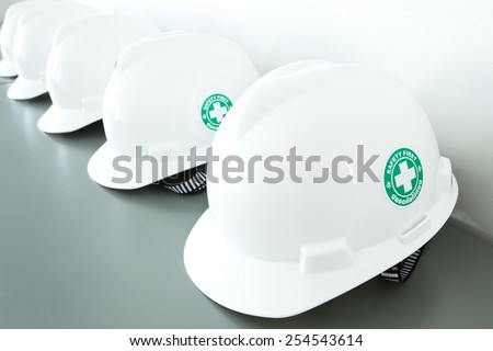 Safety caps laid out on the table. - stock photo