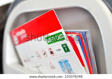 Safety card instructions in an airplane - stock photo