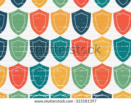 Safety concept: Painted multicolor Shield icons on White Brick wall background