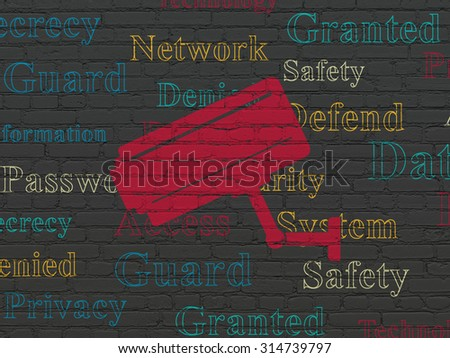 Safety concept: Painted red Cctv Camera icon on Black Brick wall background with  Tag Cloud