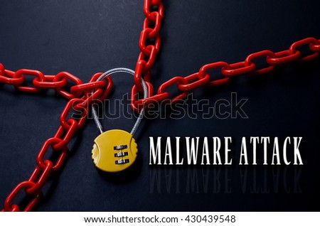 Safety Concept. Red chain and yellow padlock with number combination on blackboard with word Malware Attack. - stock photo