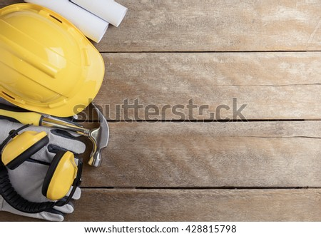 Safety equipment and tool kit on wooden background with copy space. Retro style Color