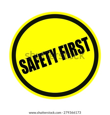 SAFETY FIRST black stamp text on yellow