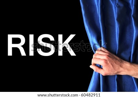 safety first concept showing risk behind blue curtain - stock photo