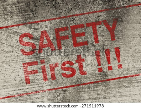 Safety first concept text is painted on old fashion wall. - stock photo