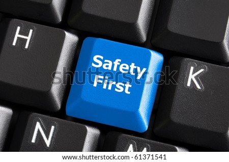 safety first concept with blue key on computer keyboard - stock photo