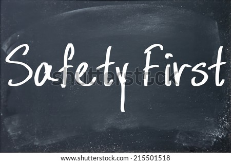 safety first text write on paper  - stock photo