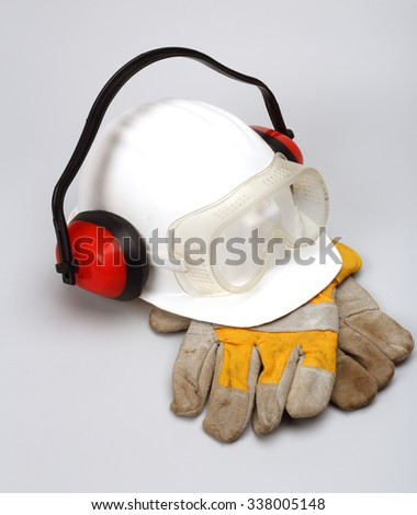 Safety gear kit close up over grey - stock photo