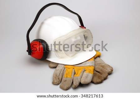 Safety gear kit close up over grey