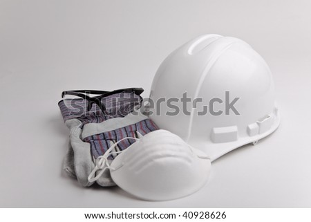 safety glasses hard hat leather gloves and medical face mask - stock photo