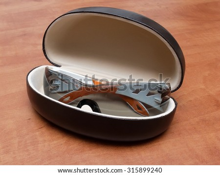 Safety glasses in case lying on a table - stock photo