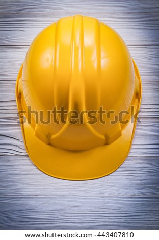Safety hard hat on wooden board construction concept. - stock photo