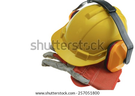 Safety Helmet and gloves and earmuffs. - stock photo