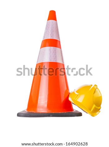 Safety helmet and traffic cone over white background - stock photo