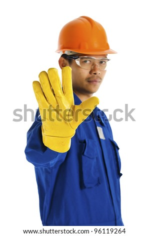 Safety officer said stop by hand sign or symbol.
