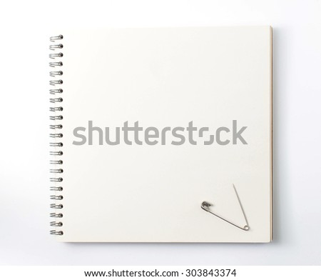safety pin on note book