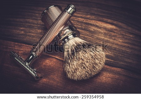 Safety razor and shaving brush on a wooden background  - stock photo