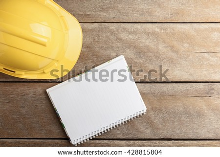 safety register with helmet on wooden background. Retro style Color - stock photo