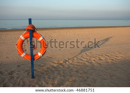 Safety ring on beach on sunny morning