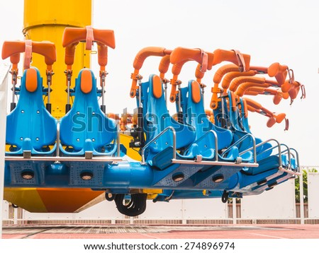 Safety seat of amusement park ride. - stock photo