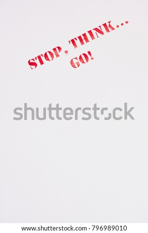 "Safety sign saying ""Stop, think...go"" on the bulkhead of a ship near to exit to open deck"