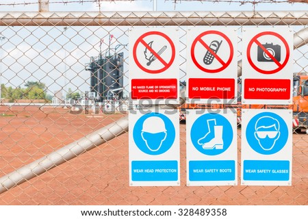 Safety signs individually in oil and gas area working - stock photo