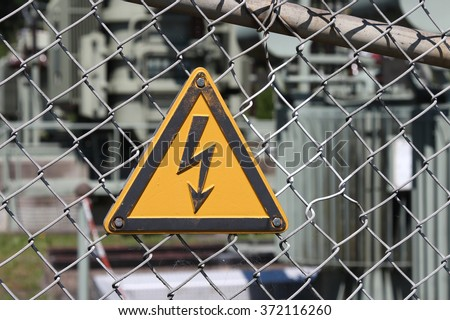 safety symbol: Caution, risk of electric shock - stock photo