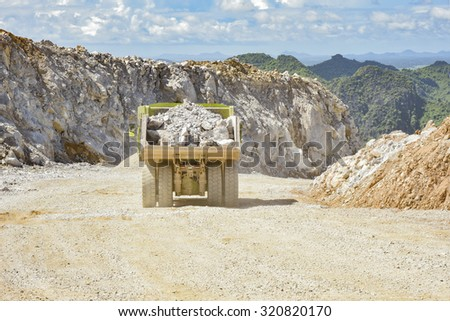 safety transportation road with bunker in a limestone quarry - stock photo