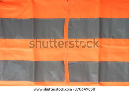 Safety vest with reflective stripes / Safety vest - stock photo