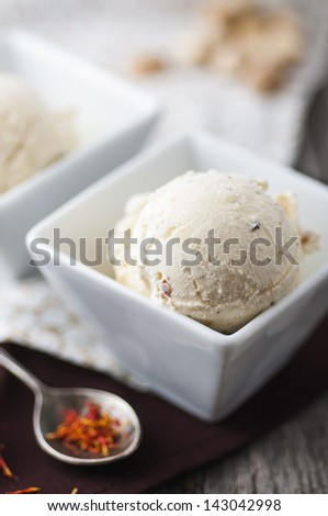 Saffron ice cream in a cup - stock photo