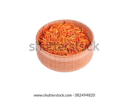 Saffron spice in wooden bowl, isolated on white background - stock photo