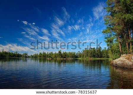 Saganagons lake on a perfect summer day in the Quetico Wilderness - stock photo