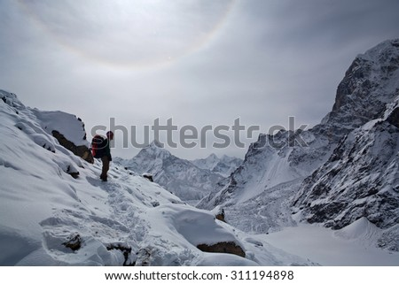 SAGARMATHA, NEPAL - MARCH 15: Tourist resting on the road to Everest Base Camp on March 15, 2010 in Sagarmatha National Park, Nepal Himalaya