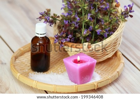 Sage and bottle of its  essential oil  - stock photo