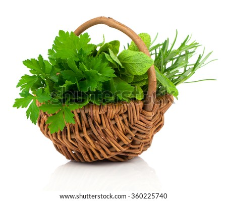 sage, parsley and rosemary in wicker basket, on a white background - stock photo