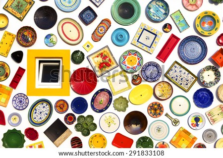 SAGRES, PORTUGAL - JUNE 07: colorful ceramic plates on the wall of the pottery store in Sagres, Portugal on June 07, 2015 - stock photo