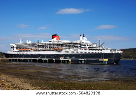 SAGUENAY, QUEBEC, CANADA - OCTOBER 8, 2016: Full view of the Queen Mary 2 cruise ship at the Bagotville wharf on the Saguenay fjord on October 8, 2016. The Saguenay flows into the St.Lawrence seaway.